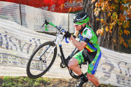 Louisville, Kentucky, Oct. 26, 2014 - Cyclist competes in the elite mens cyclocross race at Eva Bandman park.