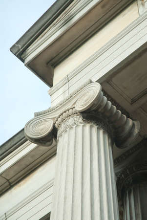 Ionic capitol atop fluted column. Beautiful example of classical design.