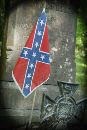 gravesite: Confederate battle flag at grave of Confederate soldier near Beaufort South Carolina.