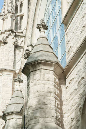 Tower with finneal on Gothic church building.   Beautiful historic architecture.