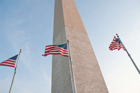 American flags flying in breeze at Washington Monument on National Mall in Washington DC