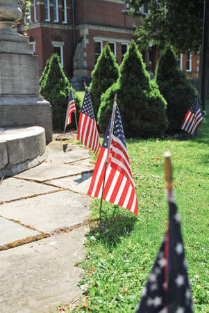 Row of American flags set out for the Fourth of July.