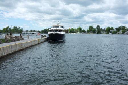 Alexander Bay, NY - May 22, 2015 - Boat docked in harbor of Alexander Bay, New York. Popular summertime tourist destination on the Saint Larwence River.