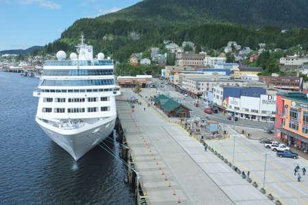 Ketchikan, Alaska, United States - June 13, 2015 - Cruise ship in harbor at Ketchikan, Alaska. This small Alaskan town is a major destination for cruise ships.