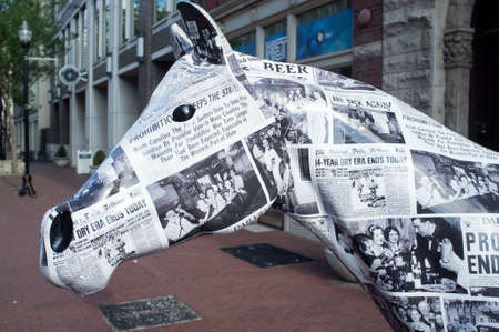 Louisville, KY - May 30: Statue of horse covered with newspapers announcing the end of prohibition on West Main Street, downtown Louisville, Kentucky. Public art celebrates the history of distilling in Kentucky.