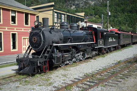 Skagway, AK, June 11, 2015 - A White Pass and Yukon Railway train arrives in Skagway, Alaska, a major tourist attraction on the Alaskan coast.