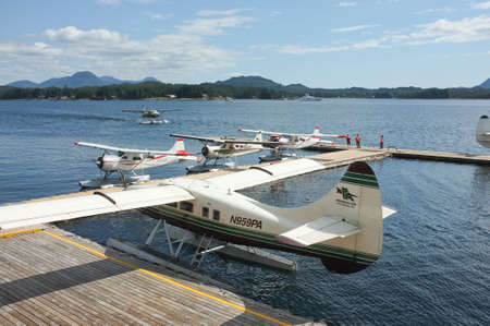 Ketchikan, AK - June 13, 2015: Floatplanes docked in harbor at Ketchikan, Alasaka. Popular form of transporation throughout the Pacific Northwest. Éditoriale
