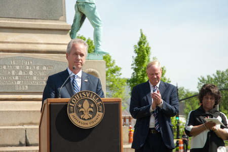 Louisville, KY - April 29, 2016: Mayor Greg Fischer announces removal of a Confederate monument from South Third Street, near the University of Louisville campus. University president James Ramsey and another official stand behind the mayor. Editöryel