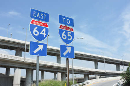 Signs for interstate highways I-64 and I-65 in Louisville, Kentucky. Symbolizes transportation, infrastructure, travel.