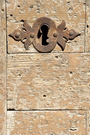 Keyhole on an old wooden door. Stock Photo - 5551938