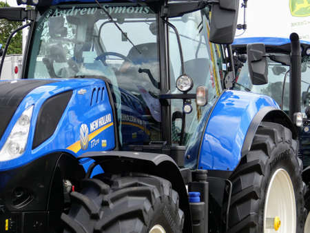 Devon, UK - July 30 2018: A New Holland agricultural vehicle being displayed