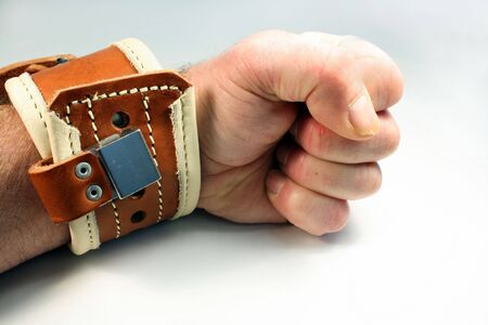 locked: wrist restraint is applied and locked to a wrist Stock Photo