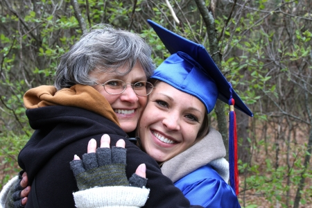 college graduation: mother and daughter hugging for college graduation
