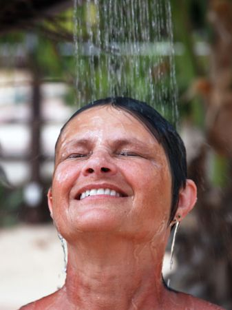 woman taking a shower outdoors Reklamní fotografie