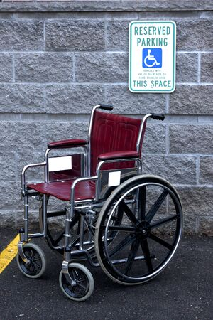 impaired: empty wheelchair in a handicapped parking stall