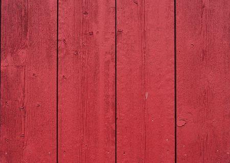rode geschilderde schuur boards maken een rustieke achtergrond Stockfoto