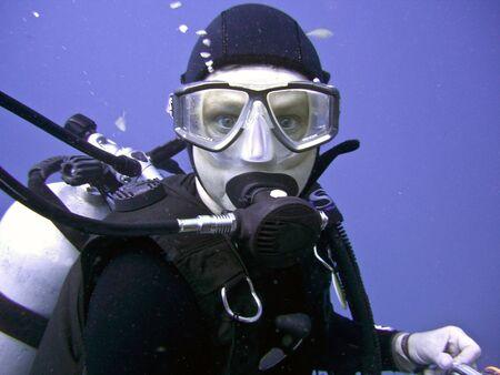 wetsuit: scuba diver portrait underwater in the ocean