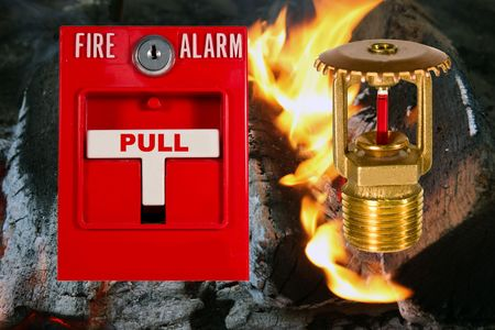 fire alarm pull station and sprinkler valve over a flame background Stock Photo