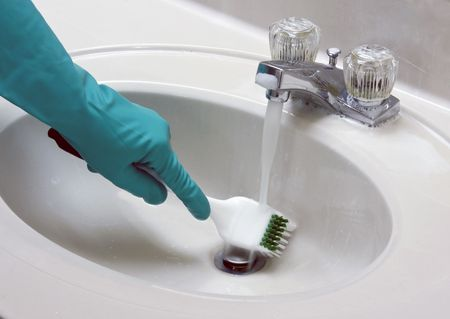 sink cleaned with a gloved hand and brush Stock Photo - 7857581