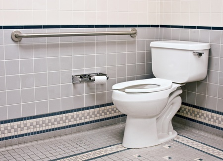 handicap bathroom with grab bars and ceramic tile photo