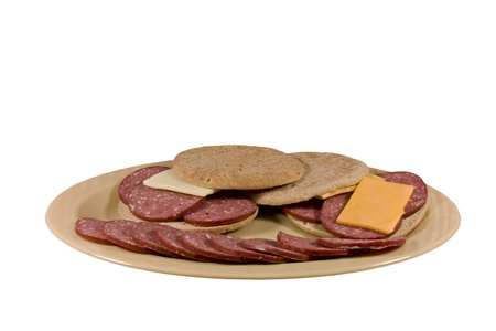 sliced meat and cheese with bread on a platter
