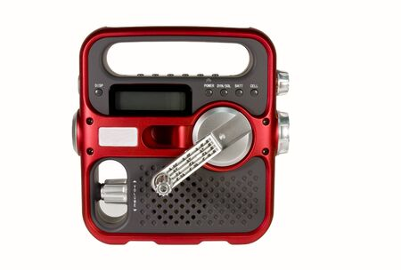 hand crank: hand crank powered emergency radio isolated over white background