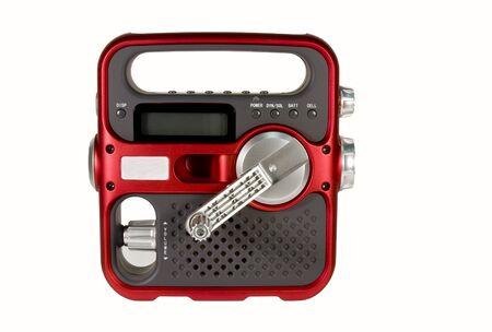 handslinger aangedreven noodradio geïsoleerd over witte achtergrond Stockfoto
