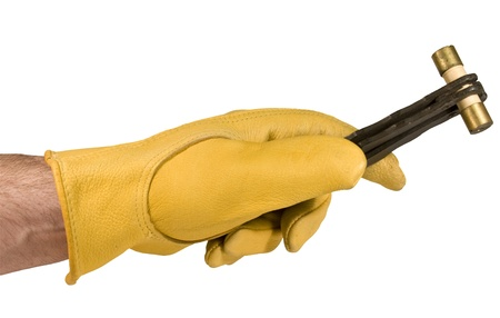 electrician with gloved hand holding a fuse in a fuse puller isolated over a white background