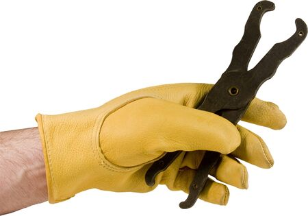 insulated electricians fuse puller held in glove