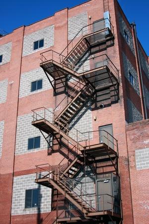 escape: fire escape attached to a brick building