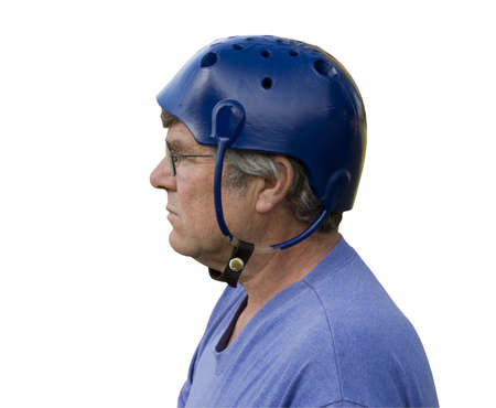 seizure: man wearing a padded seizure helmet isolated over a white background with a clipping path at original size Stock Photo