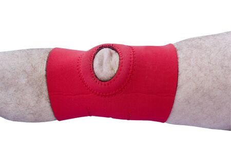 immobilize: injured knee in a padded support brace isolated over a white background with a clipping path at original size Stock Photo