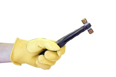 electricians gloved hand holding a fuse puller with a fuse in it isolated over a white background at original size 版權商用圖片