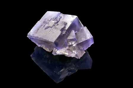 fluorite: fluorite crystal with a reflection over a black background Stock Photo