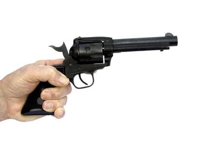 hand pointing a revolver isolated over a white background with a clipping path at original size