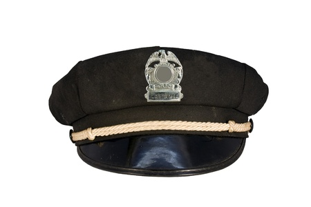 corporal: vintage police motorcycle cap with badge isolated over a white background