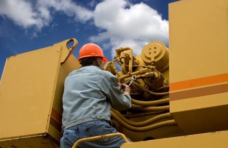 onderhoudsmonteur reparatie van zwaar materieel machines Stockfoto
