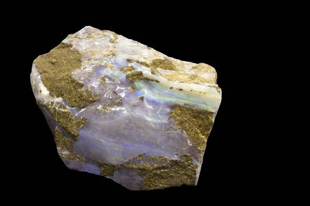 precious stone: opal formations on a rock isolated Stock Photo
