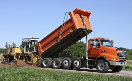 grader: dump truck and grader doing highway construction