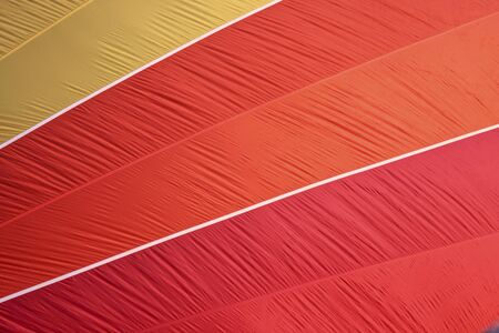 hot air balloon fabric being filled makes a colorful background