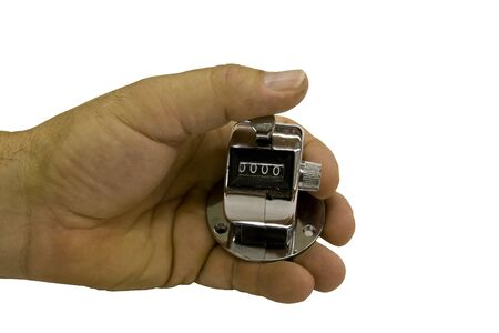 tally: hand holding a thumb on a tally counter isolated over a white background