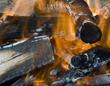 campfire backgroung with flames and burning logs Stock Photo