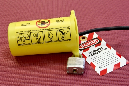 lock out: electrical cord secured in a lock out tag out container Stock Photo