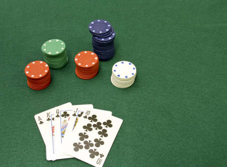 wager: royal flush poker hand with chips and a green felt background