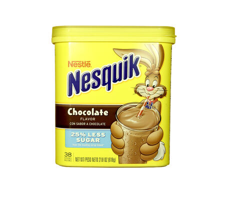 nestle: SPENCER , WISCONSIN - JANUARY  21, 2014 : box of Nesquick Chocolate Flavor Drink Mix. Nesquick is by Nestle a multinational food and beverage company founded in 1866