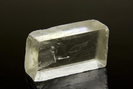 salt crystal: raw salt crystal close up over a dark  Stock Photo