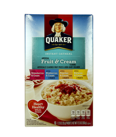 cereal box: SPENCER , WISCONSIN May 15 , 2014:  Quaker Fruit and Cream Instant Oatmeal. The Quaker Oats Company was founded in 1901 it is an American food conglomerate. Editorial
