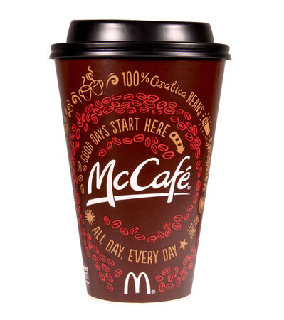 caffiene: SPENCER , WISCONSIN June 6 , 2014:  cup of McCafe Coffee. McCafe coffee is made by McDonalds, the largest fast food restaurant chain. Editorial