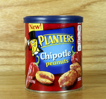 SPENCER , WISCONSIN June 22 , 2014:  can of Planters Chipotle Peanuts. Planters is an American snack food company, a division of Kraft foods.