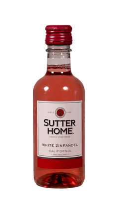 white zinfandel: SPENCER , WISCONSIN Aug. 11 , 2014:  bottle of Sutter Home White Zinfandel  Wine. Sutter Home Winery was established in 1890 and is the largest family owned winery in the United States